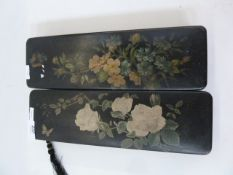 Two oriental lacquered glove boxes, black lacquer with red interiors, floral decorated 30 cm x 9.5cm