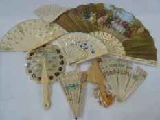 Two pierced bone and painted fans, a miniature pierced bone fan and various ivory type fans, some