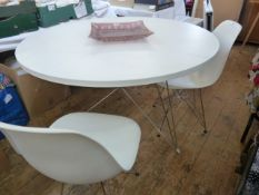 Charles and Ray Eames for Vitra, two 'DSR' chairs, white moulded shells on Eiffel-type bases and a