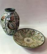 A large Denby stoneware vase, 30cm high and a Denby circular dish, 31cm in diameter bothdesigned by