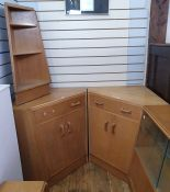 Pair of 20th century oak G-Plan corner cupboards, each with single drawer above two cupboard