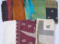 Seven silk saris, assorted colours (7)