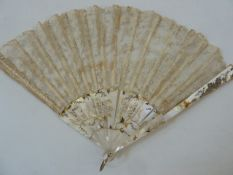 A 19th century mother of pearl and lace fan, one side the mother of pearl floral decorated with gilt