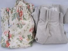 Two pairs of short linen French pleat headingsin pale green with white spots and floral curtains