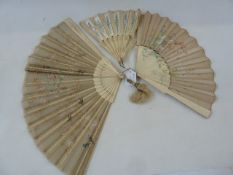 A late 19th century bone and painted gauze panel fan, floral and bird decorated with lace detail,