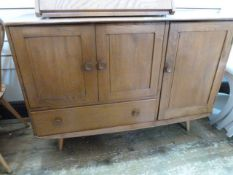 Ercol blonde elm sideboard having double doored cupboard with single drawer below and further single