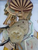 A quantity of Oriental circular fan/ hand screens, some gauze and hand painted, a horn hand