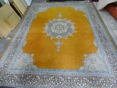 Eastern mustard ground rug with central medallion, stepped border, 374cm x 278cm