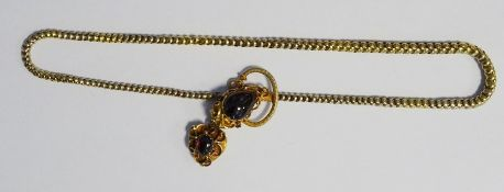Victorian gold-coloured metal and cabochon garnet necklace, the snake-pattern chain with ornate