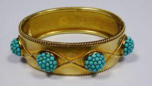 Victorian gold coloured metal hinged bangle having raised turquoise set circular balls within