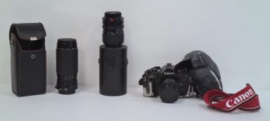 Canon A-1 camera, a Sigma Jessop 52mm 1A lensin case and a Sigma 55MM Skylight (1B) zoom lensin