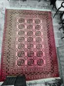 Persian rug with 21 elephant foot guls to the red ground field, stepped border, 270cm x 195cm