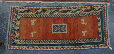 Pink ground rug with central rectangular motif, animal decoration, in pinks, whites and blues, 193cm
