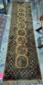 Mustard ground runner with nine elephant foot guls, in yellows and blacks, 75cm x 250cm approx