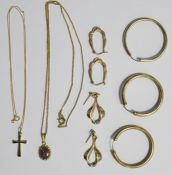 9ct gold crucifix on 9ct gold chain, a pair of 9ct gold hoop earrings, another gold hoop earringand