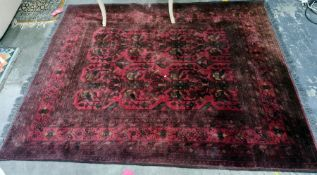 Red ground rug with foliate design, stepped border, 190cm x 135cm approx