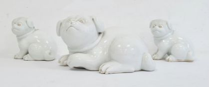 Three Japanese Meiji period Hirado porcelain model of Akita puppies, each modelled in a seated