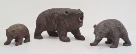 Carved Black Forest bearwith glass eyes and white teeth (one eye missing and some teeth missing),
