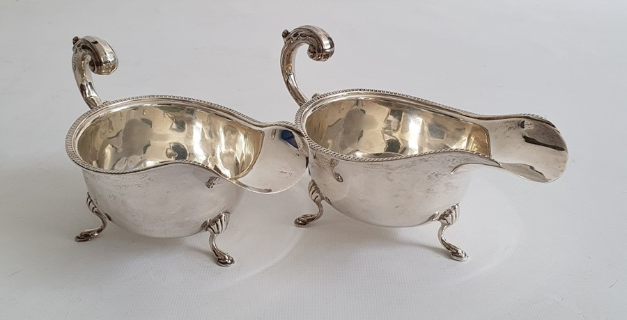 Pair of Edward VIII silver sauce boatson splayed feet, with egg and dart decoration to rim,