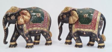 Pair of carved and decorated elephants, gilt highlighted, 26.5cm high (2)