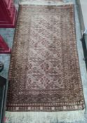 Eastern rug, the central field with hooked diamond medallions, stepped border, 185cm x 100cm approx
