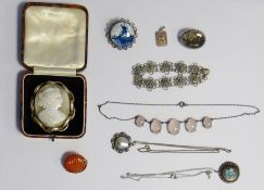 Cameo broochset in gold-coloured mount, a silver-coloured pendantwith turquoise and shell inlay, a