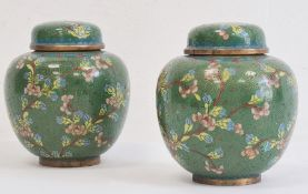 Pair of cloisonne enamelled ginger jars and domed covers, decorated with flowering prunus