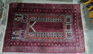 Eastern rug, red ground, stepped border, red plaques and white, 132cm x 90cm