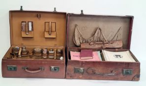 Leather suitcase with various music sheets and a leather suitcase with dressing travelling set to