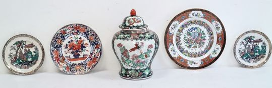 20th century Oriental lidded vase in black, green and red, two Oriental plates and two Oriental-