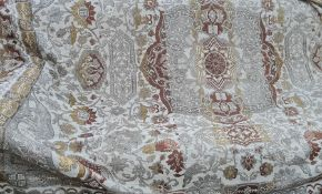 A textile throw, beige ground with central medallion in brown and yellow with decoration of stags