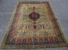 Yellow ground Eastern rug, the central medallion on a foliate decorated field, stepped border, 368cm