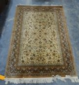 Modern cream ground rug with allover foliate decoration, 197cm x 141cm and another similar,