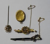 Victorian gold broochdecorated with harp and clovers (marks worn), a gold-coloured locket, a gold