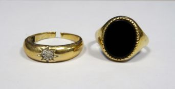 Gent's gold-coloured metal and onyx dress ringand a gent's gold-coloured ringset small diamond