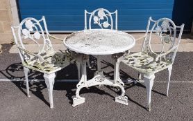 White painted circular aluminium garden table of Tudor rose design with three matching chairs,