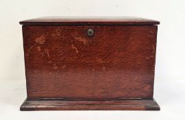 Late 19th century oak table-top desk tidy, the lift-up top enclosing compartmented interior, with