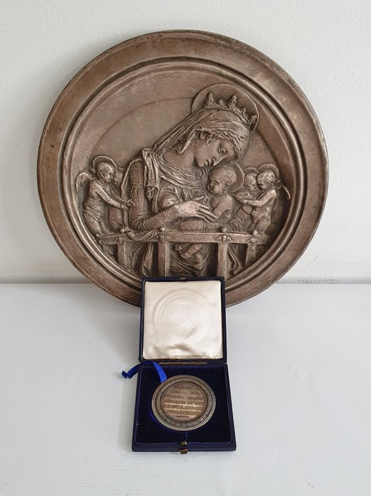 20th century silver-mounted circular plaque'The Chellini Madonna' after Donatello, marked verso,