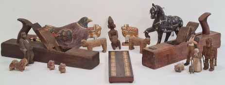 Various carved wooden animalsto include jaguars, dogs, African carved figures, carved wooden