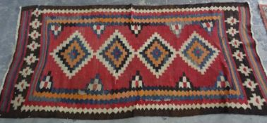 Modern rug, red ground with stepped diamond-shaped medallions, stepped border, 242cm x 114cm