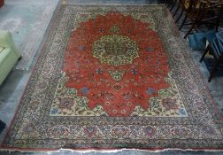 Pink ground Eastern rug with central medallion, foliate decorated field and stepped foliate