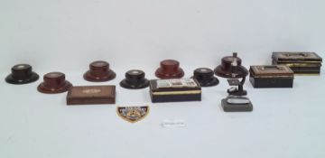 Quantity of enamel and other badges, assorted buttons, money boxes, wooden trophy stands, postcards,