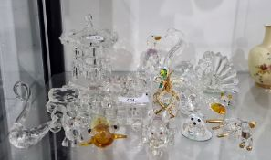 Quantity of Swarovski itemsto include swan, dog, rabbit, elephant, carousel, etc Condition