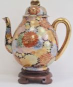 Early 20th century Japanese porcelain oviform teapot, cover and hardwood stand, gilt character