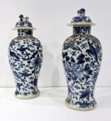 A pair of Chinese lidded baluster vases, full character mark for Kangxi (both damaged)(23cm)