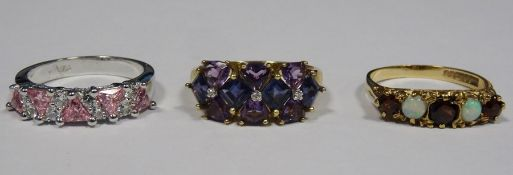 9ct gold, amethyst-coloured stone and diamond dress ringset three small diamonds surrounded by