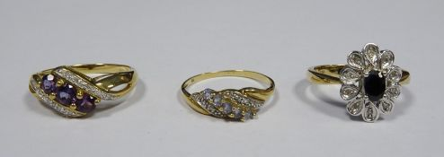 9ct gold, diamond and amethyst-coloured stone dress ring set three amethyst-coloured stones with