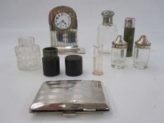 1930s silver rectangular cigarette case initialled BCF, 2oz, a silver mounted mantel clock, a silver