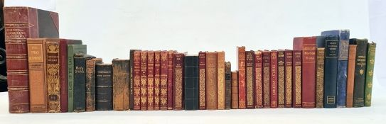 Various volumes to includeWalter Scott, George Elliot,Goethe, a New Testament with carved olive