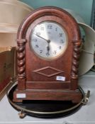 1950's oak-cased mantel clockwith barley twist columns and Arabic numerals and a black and brass